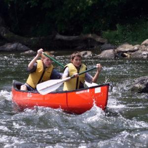 two teen boys enjoying their canoe trip Downriver Canoe Company Shenandoah Valley River
