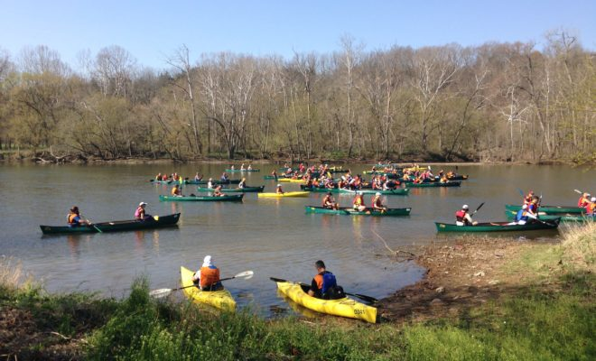 large canoe and kayak group are about to race each other Downriver Canoe Company Shenandoah Valley River