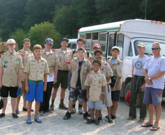 scouts troop poses in uniform as they get off the bus Downriver Canoe Company Shenandoah Valley River