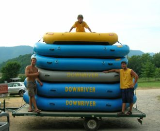 three employees have loaded up rafts on the trailer and are ready to go Downriver Canoe Company Shenandoah Valley River