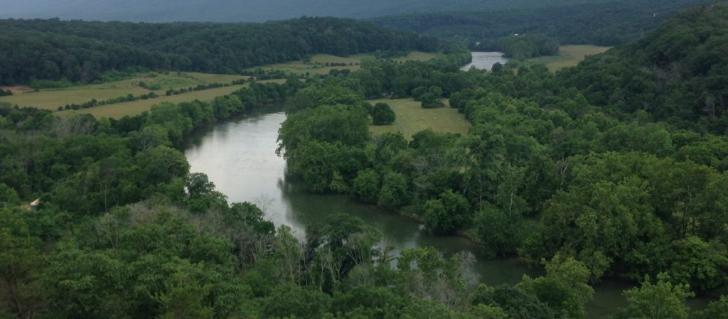 aerial view of lots of trees surrounding the winding river Downriver Canoe Company Shenandoah Valley River