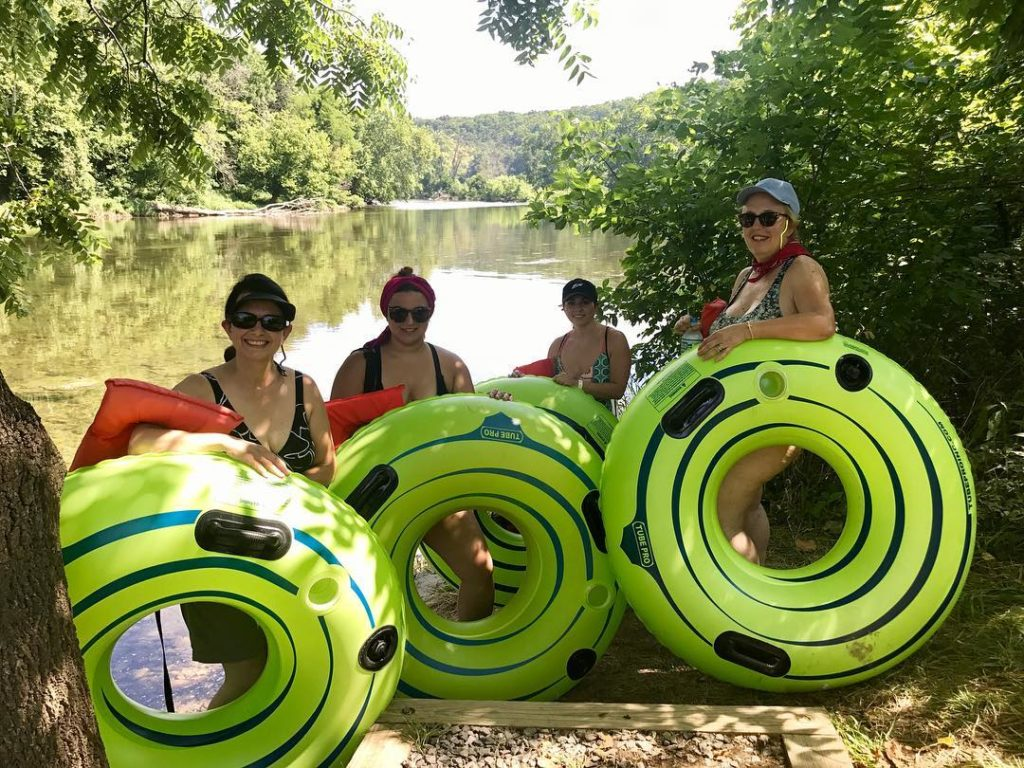four women take a break in the shade during their tube adventure Downriver Canoe Company Shenandoah Valley River