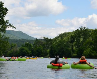 several tubers relaxing on the calm waters Downriver Canoe Company Shenandoah Valley River