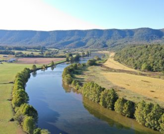 a scenic look at the calm river Downriver Canoe Company Shenandoah Valley River
